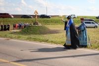Митрополит Орловский и Болховский Тихон освятил поклонный крест на опасном участке автодороги «Орёл — Знаменское» вПахомовском сельском совете. 20 июля 2019 г.